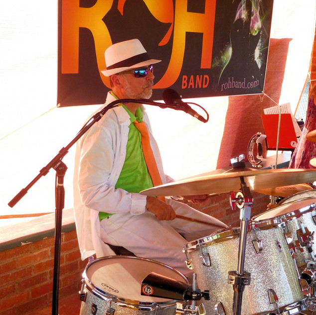 Long, Cool Drummer in some white pants..