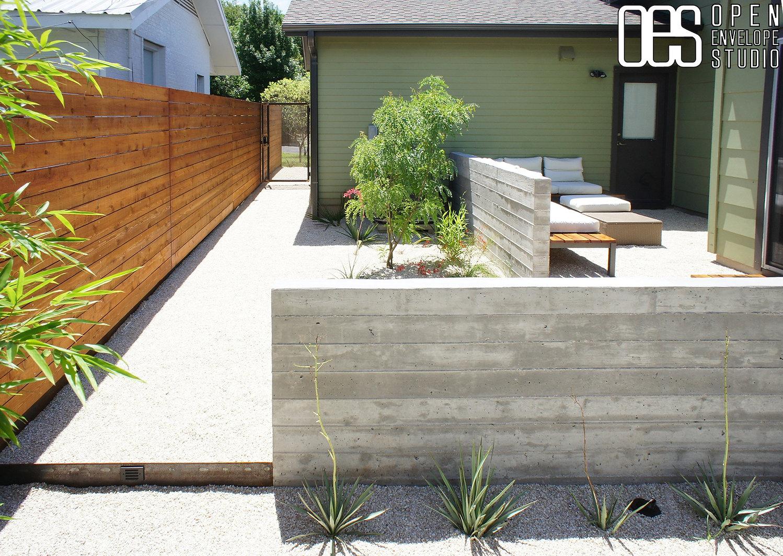 OES | board form concrete walls, custom bench, horizontal fence, native plants