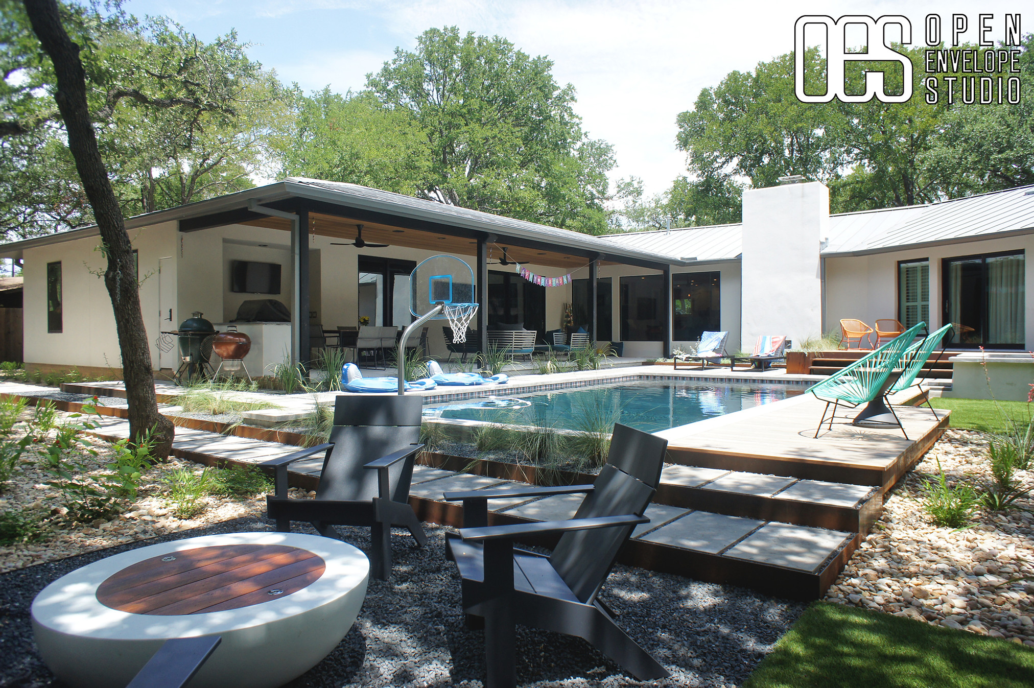 OES | pool and hot tub with floating pavers, ipe decks, artificial turf, steel edging, planting beds, Lueders pavers, Texas basalt gravel