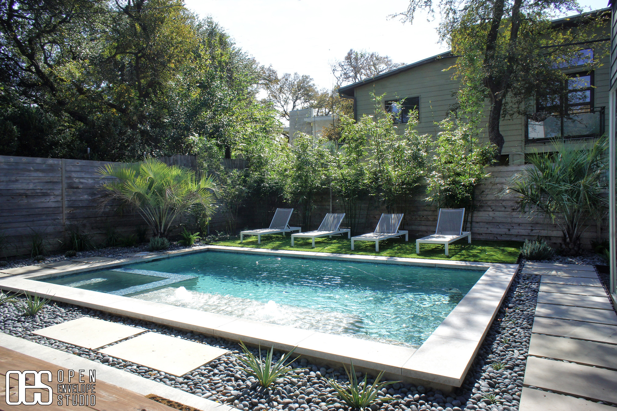 OES   pool installation management, limestone pavers, mexican moon pebbles, artificial turf, clumping bamboo for privacy screening, pindo palm trees, other vegetation