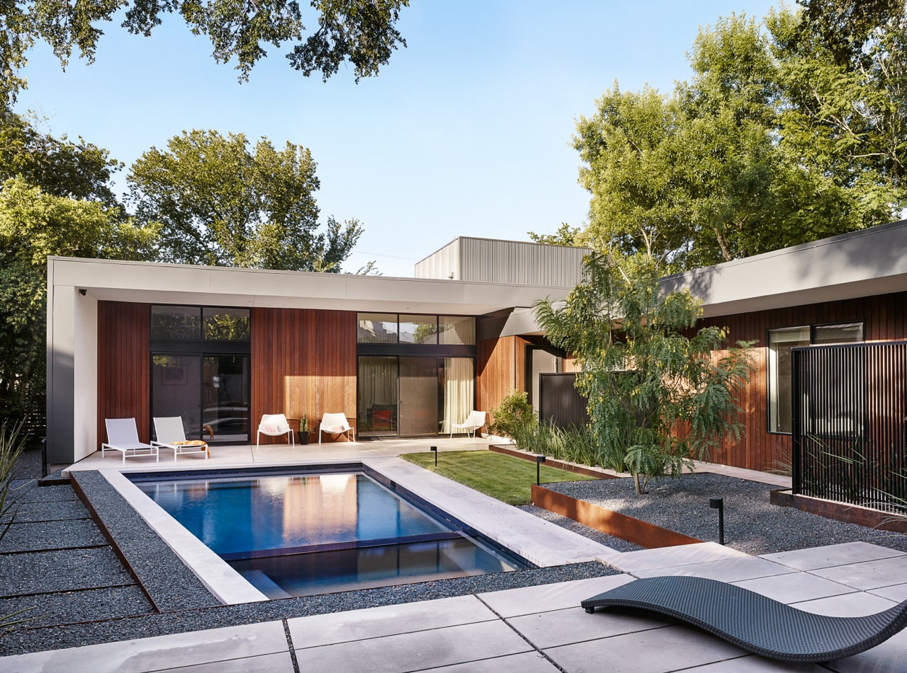 OES | Courtyard with pool, limestone pavers, turf grass, steel retaining walls, and native plants. Photo credit: Casey Dunn