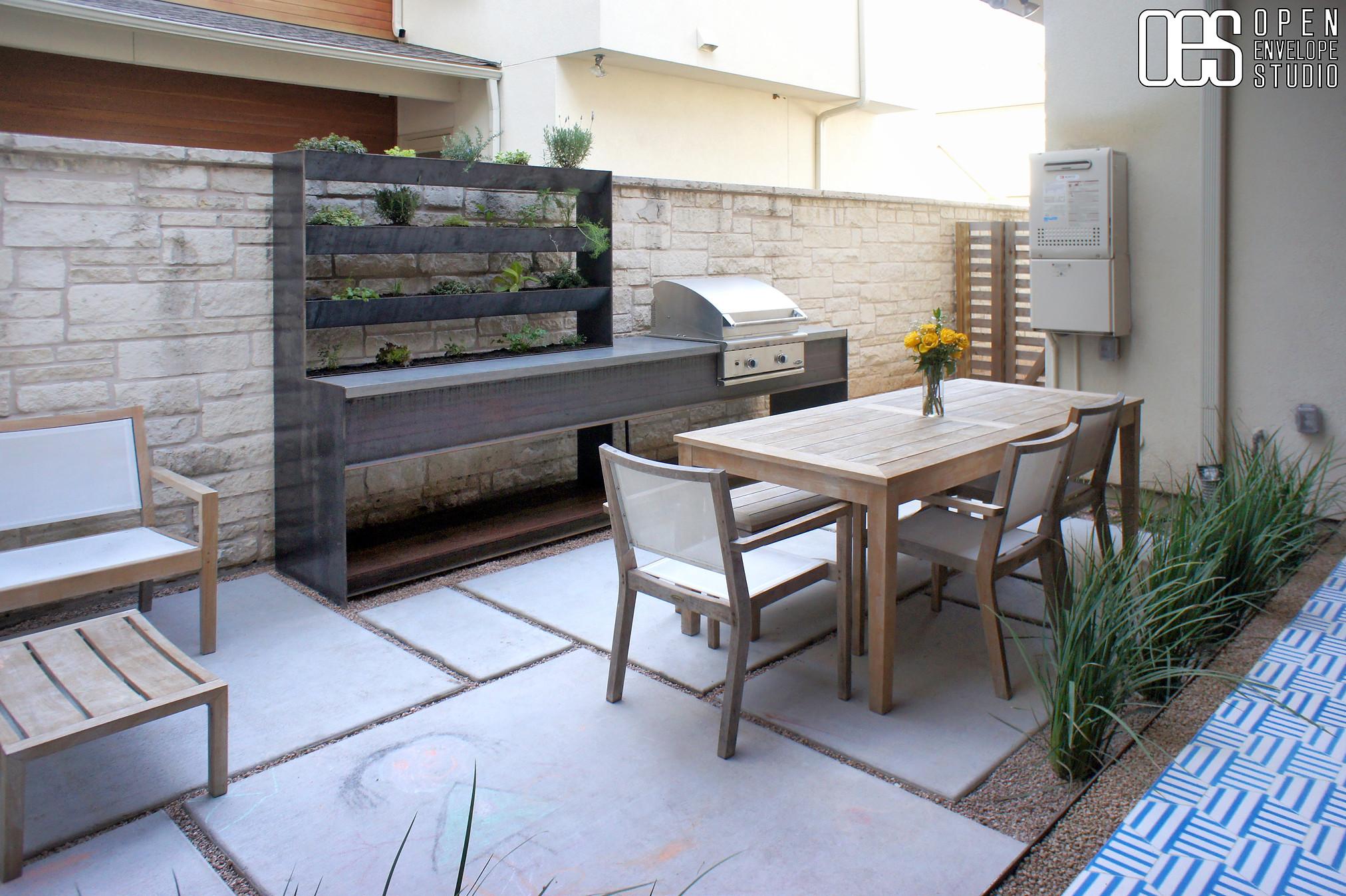 OES | concrete pavers, custom steel grill countertop + credenza planter, pea gravel, and strategic planting