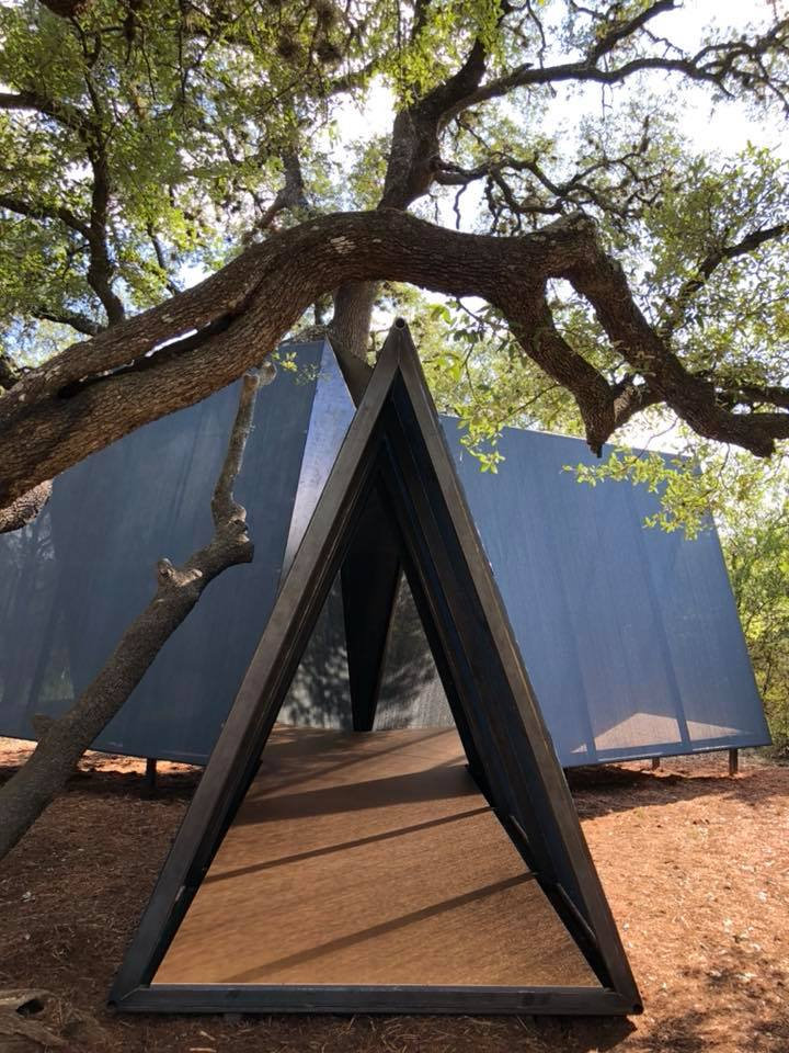 OES | custom tarps stitched over three steel tube framed tents, plywood floor and steel aperture where tents converge in the center of the fort.