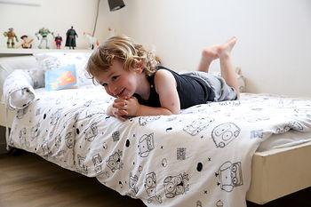 One happy toddler enjoying his Toddler Bed Set (Duvet & Pillow case)