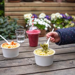 kids pesto pasta being eaten.jpg