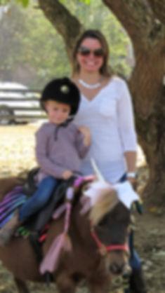 child sitting on a pony