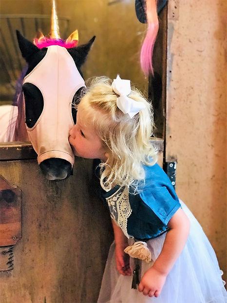 Little girl kissing a pony jpeg