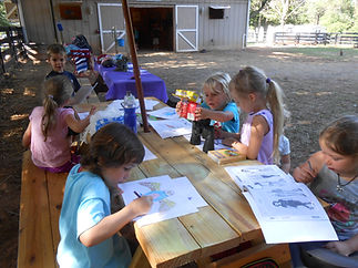 Kids at summer horse camp