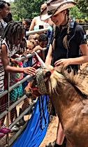 Child standing in front of horse