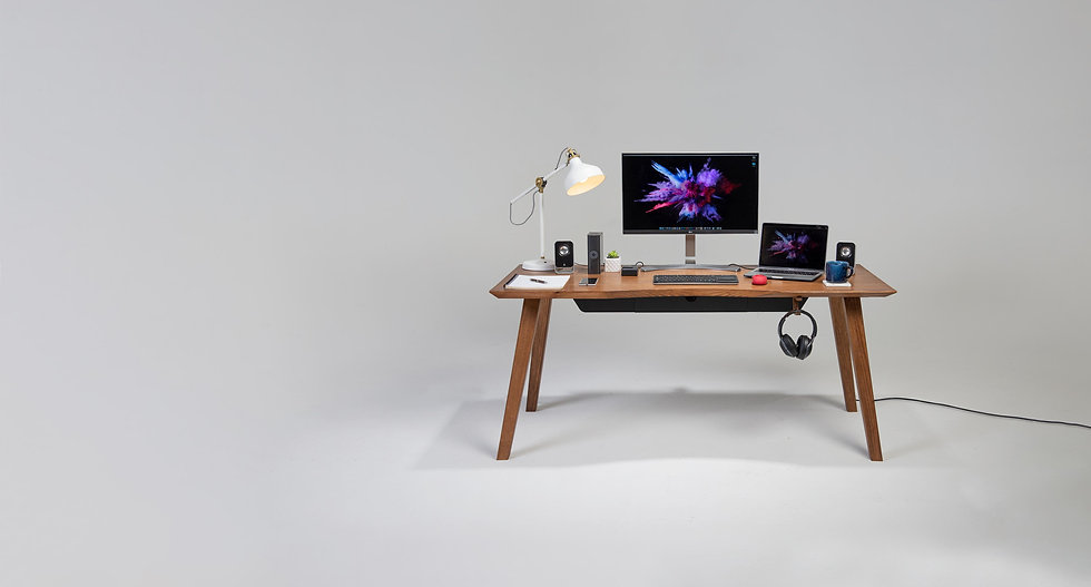 Mesa 57, an Australian made mid century modern solid wood desk made from Vic Ash that is 1600mm long and has built in cable management, power outlets and wireless charging.