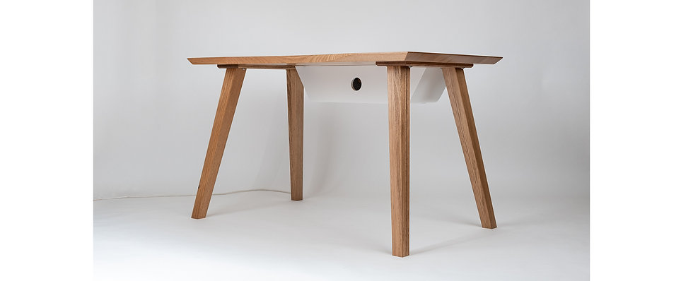 Mini Mesa, an Australian made mid century modern solid wood desk made from Vic Ash that is 1200mm long and has built in cable management, power outlets and wireless charging.