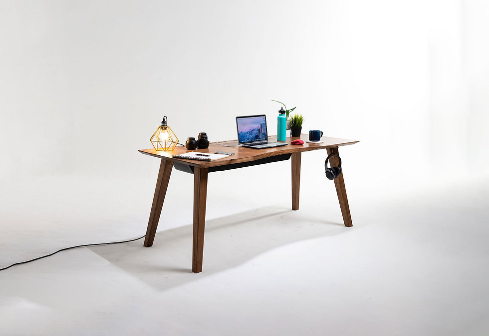Mesa 57, an Australian made mid century modern solid wood study desk made from Vic Ash that is 1600mm long and has built in cable management, power outlets and wireless charging.