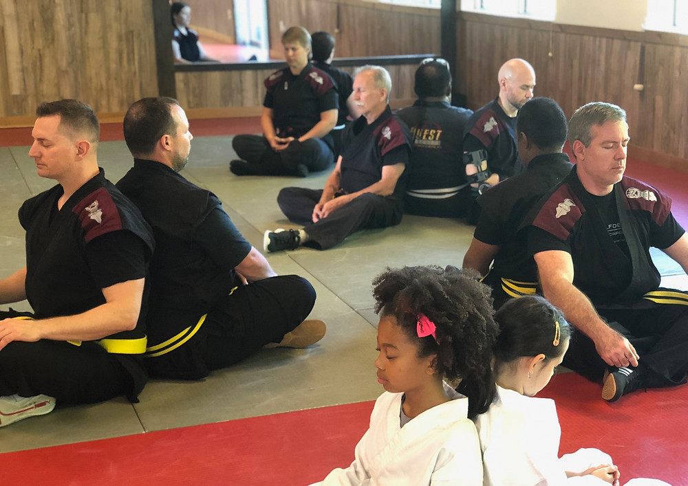 Toshindo martial arts students practicing positive visualization at the Quest Self Defense school in Tampa, FL.