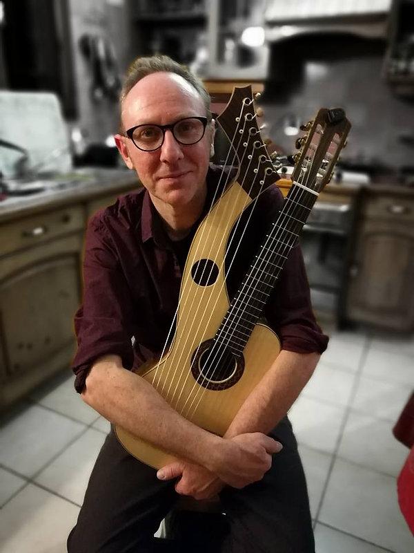 Sean Woolley with soprano harp guitar