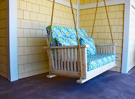 Whitewashed cedar porch swing