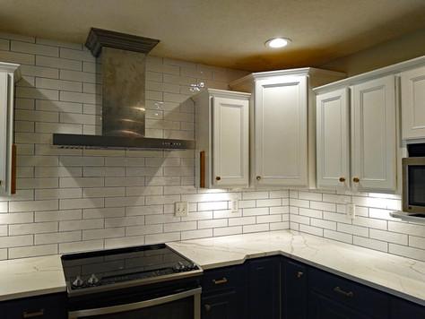 Tile backsplash and range hood installation
