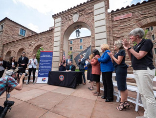 Governor signs bills at CU Boulder in support of college affordability