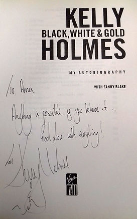 Believe It Coaching/photos/Dame Kelly Holmes signature in book