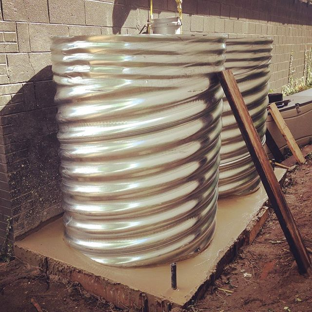 Setting a couple more galvanized steel rain tanks today - this time for the PAST Innovation School i