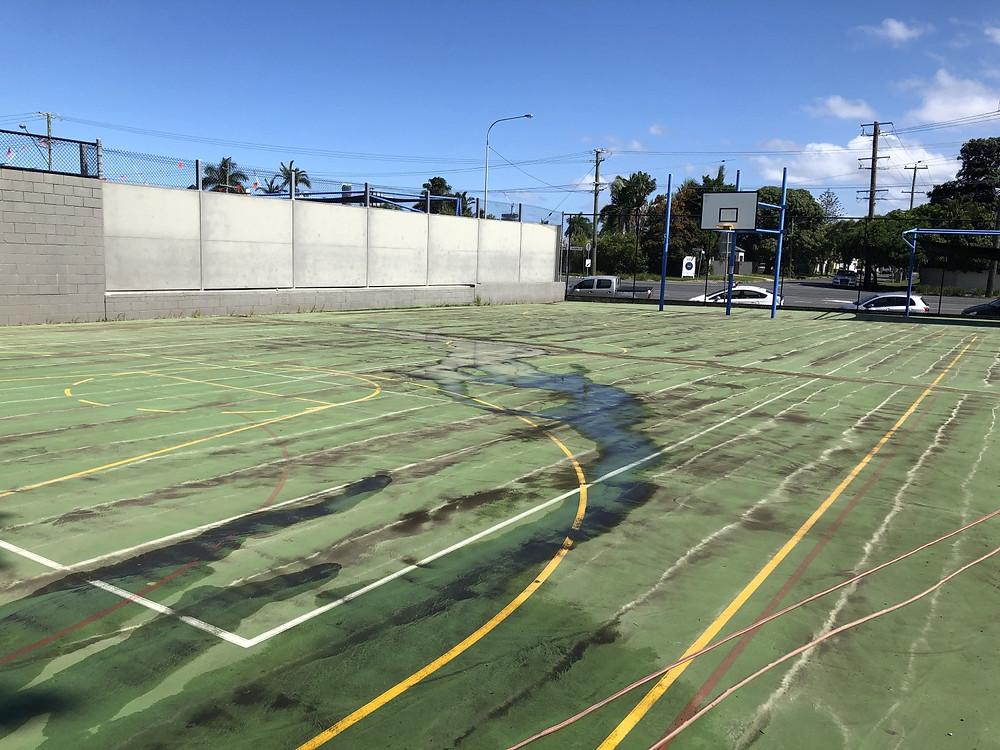 Half way through pressure cleaning tennis court