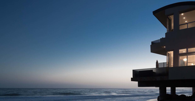 Modern ocean home at dusk