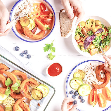 Flat lay of family hands eating healthy food. Vegan lunch table top view_edited.jpg