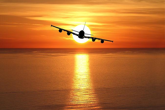 bigstock-Beautiful-sunset-with-airplane-