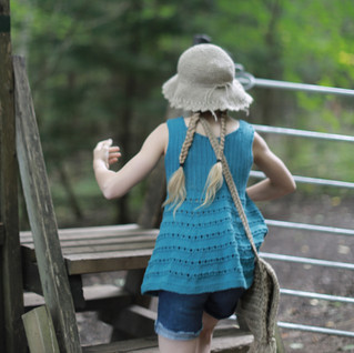 Little explorer with knitted tunic, crochet hemp hat and a hipster handbag. Knit & crochet pattern designs. Handmade with love, by you.