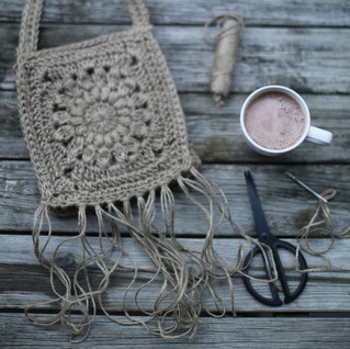 Behind the scenes. Crocheting and hot chocolate. Slow made kids fashion. Sustainable hemp material.