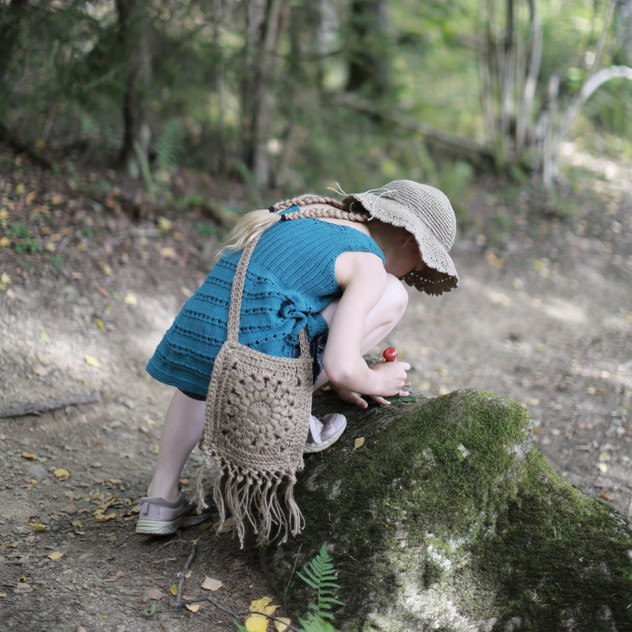 Little girl exploring. Hipster tunic, hat and handbag. Knitted and crocheted. Patterns in store.
