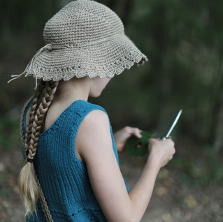 Forest girl with scout knife. Let the kids. Knitted tunic and crochet hemp hat pictured. Pattern designs by Prinser & Prinsesser.