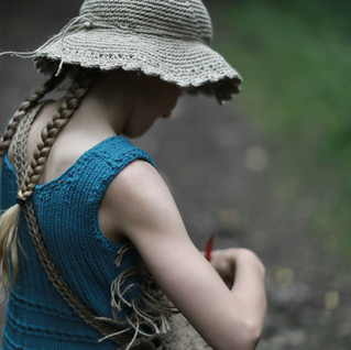 Forest girl with hipster tunic, hemp hat and handbag. Knit & crochet pattern designs.