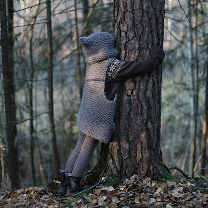 Knitted thick and warm vest with a big cosy hood for wild and free kids who are hugging trees and collecting forest treasures