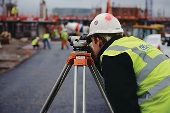 surveyor looking through a level