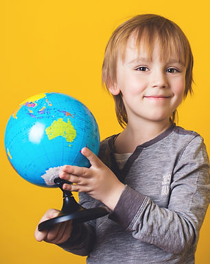 bigstock-Happy-Little-Boy-With-Globe-I-2