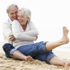 bigstock-Senior-Couple-Sitting-On-Beach-