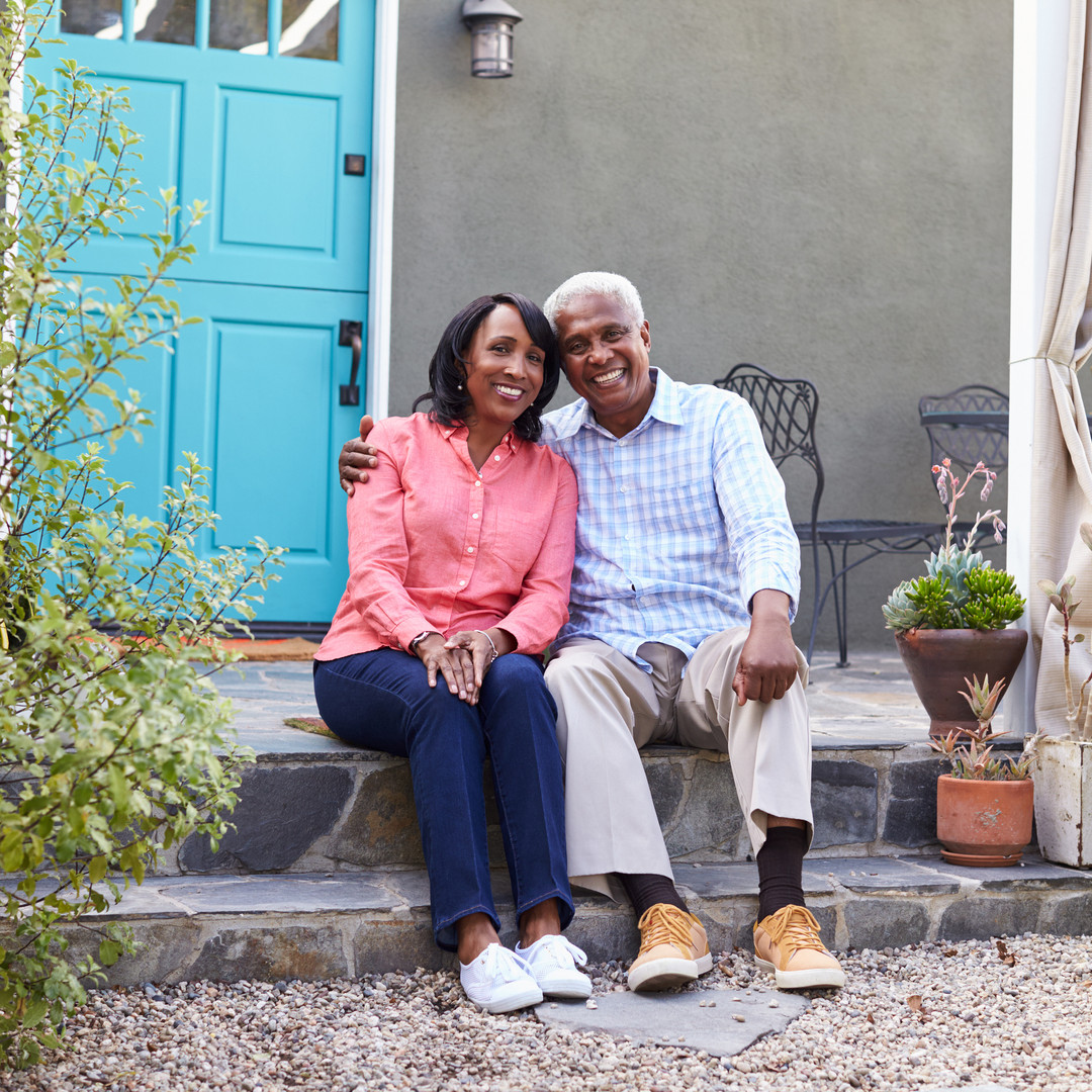 bigstock-Senior-couple-sit-on-steps-out-