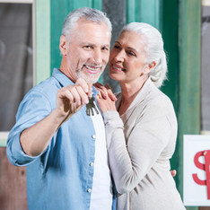 bigstock-Smiling-Senior-Couple-Holding--