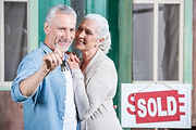 bigstock-Smiling-Senior-Couple-Holding--