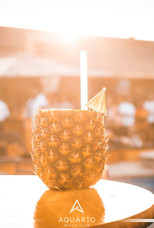 refreshing cocktail in a pineapple in the sun
