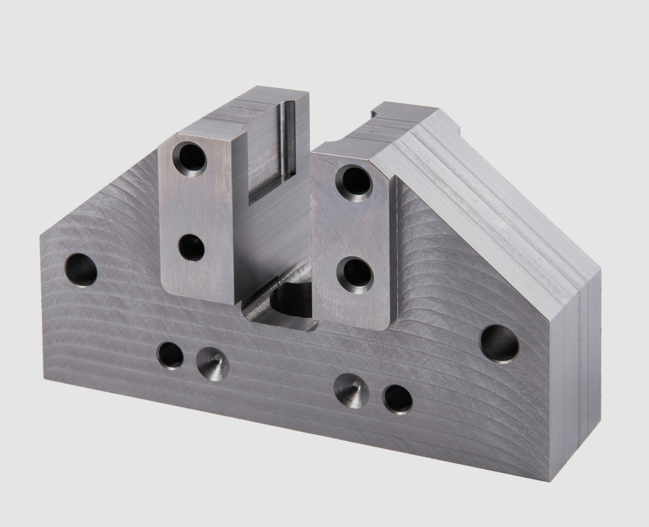 A complex machined metal part by Progressive Machining.
