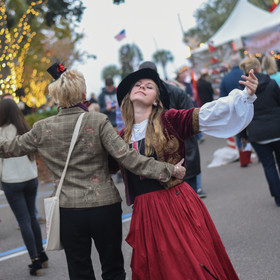 Kate dances with the audience at Dickens
