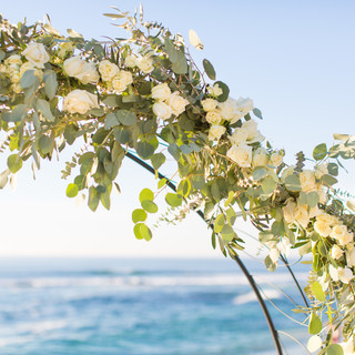 Round Floral Arch for wedding ceremony on Windansea Beach, in La Jolla, CA