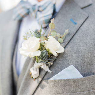 Garden Style Seeded Eucalyptus and Blue Thistle Boutonniere on Grey Tux