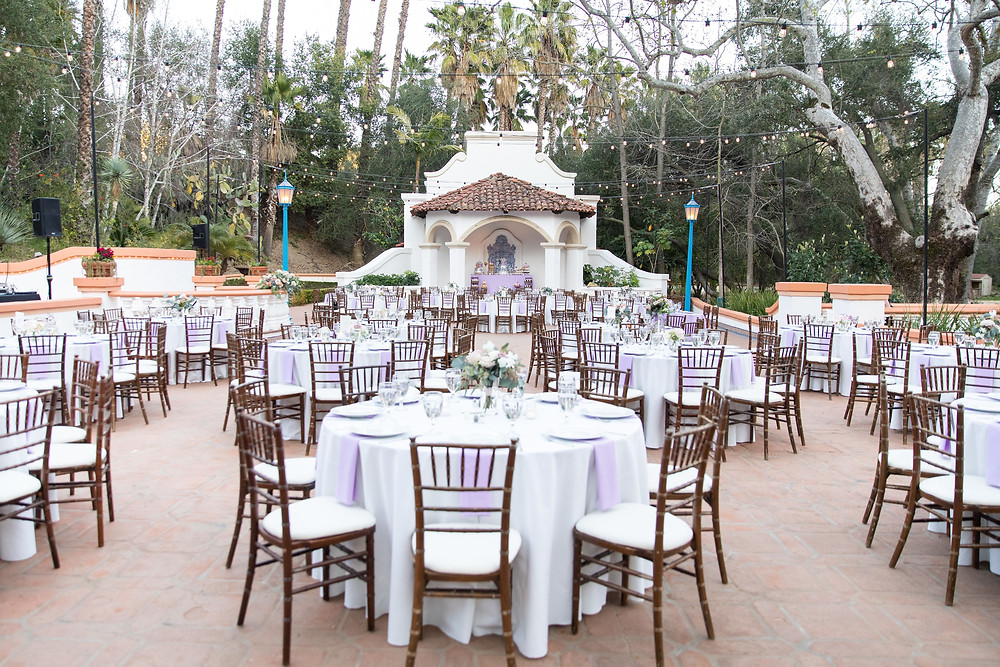 Sweet and simple centerpieces for a purple wedding, filled with eucalyptus, sweet peas, carnations, ranunculus, lilac, spray roses, and amnesia roses that perfectly matched their purple and mauve color palette  for a stunning wedding at Rancho Las Lomas in Orange County, CA made by San Diego wedding florist Le Champange Projects