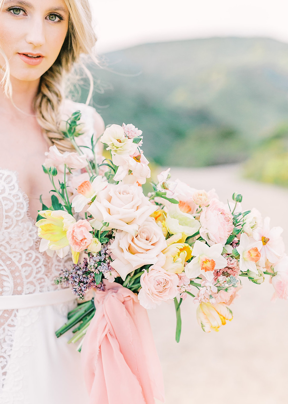 Spring micro wedding/elopement flowers setup in at Mission Trails in San Diego, California. Amongst the best places to elope in San Diego. Using vibrant and bright wedding flowers to create an intentional ceremony setup by Southern Californian Florist Le Champagne Projects. Photography by fine art film photographer Mandy Ford
