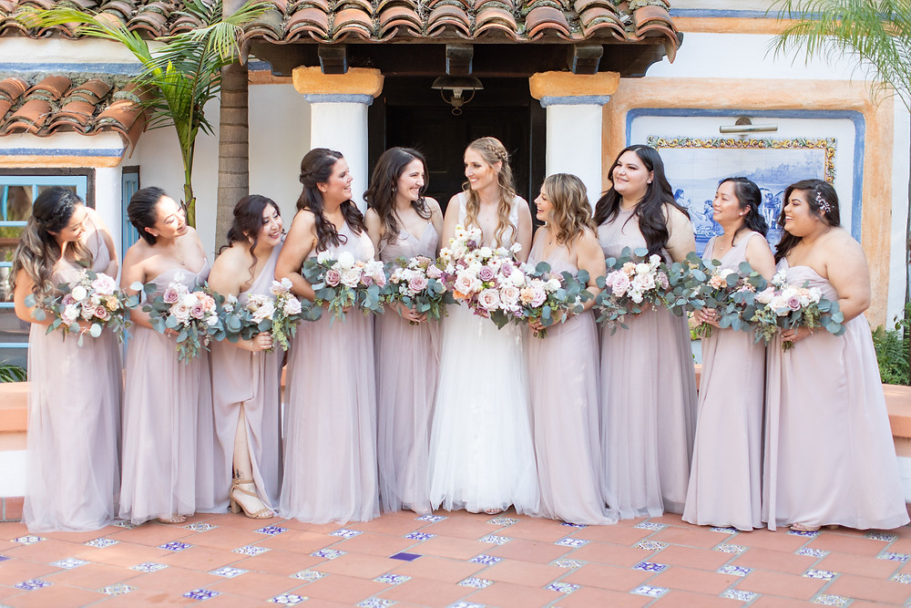Beautiful lush floral heavy purple bridal bouquet filled with lilac, hellebores, roses and butterfly ranunculus made by San Diego wedding florist Le Champange Projects for a stunning Spring wedding at Rancho Las Lomas in Orange County, CA with a purple color palette.  Bridesmaid bouquets.