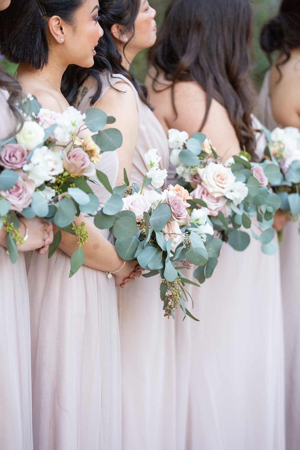 Sweet and dainty posy bridesmaids' bouquets for a purple palette wedding, filled with eucalyptus, sweet peas, carnations, ranunculus and roses that perfectly matched their mauve bridesmaid's dresses for a stunning wedding at Rancho Las Lomas in Orange County, CA made by San Diego wedding florist Le Champange Projects