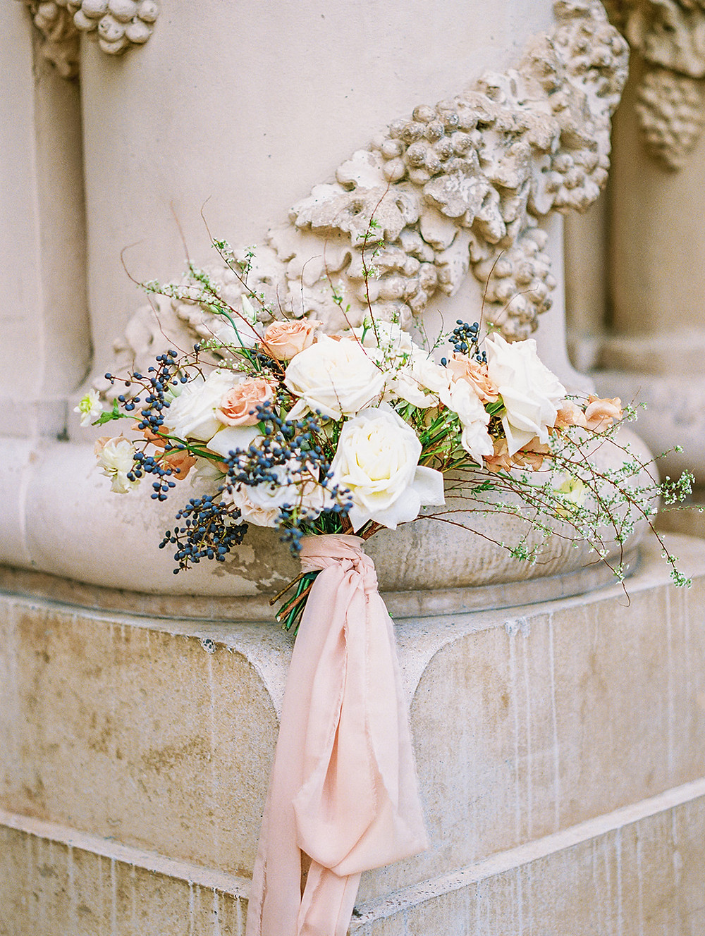 Whimsical and Neutral Spring Time Bouquet for a 1920s Inspired Wedding at Balboa Park San Diego Beautiful, whimsical and organic Spring time wedding flowers with neutral color palette. This gorgeous bridal bouquet was inspired by the 1920s and the venue: Balboa Park. We played with the neutral color palette with a punch of peach using garden roses, spirea and privet berry. #sprirea #spireabouquet #springbouquet #springweddingflowers #sandiegoflorist #sandiegoweddingflorist #neutralweddingpalette #peachweddingflowers