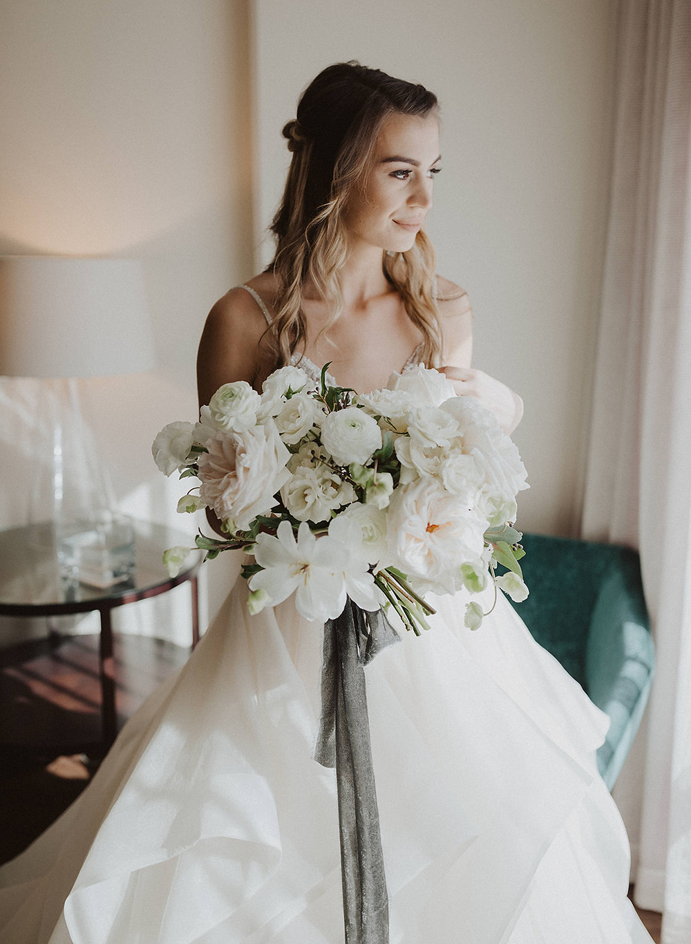 Elegant white, blush and black bouquet for a Black Tie wedding in downtown San Diego at The Ultimate Skybox, filled with garden roses, tulips, ranunculus and hellebores, made by San Diego Wedding Florist, Le Champagne Projects. #blushbouquet #bridalbouquet #blacktieweddingflowers #fallweddingflowers #autumnbouquet #whitebridalbouquet #elegantbouquet #gardenrosebouquet #sandiegoweddingflorist #sandiegoflorist